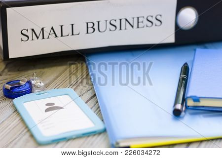 Planning Business Concept - Small Business Documents, Notepad And A Pass. Rough Bords Background. Cl