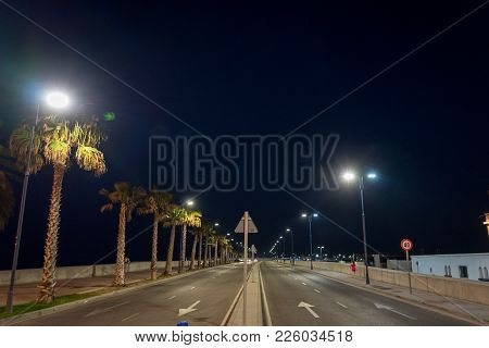 Empty Street Of Malaga Light By Lamps At Malaga, Spain, Europe