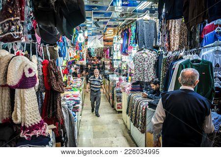 Tehran, Iran - October 16, 2016: People In Clothes Shop On Grand Bazaar In Tehran City