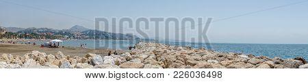 Panoramic View Of The Ocean At Malagueta Beach With Rocks At Malaga, Spain, Europe