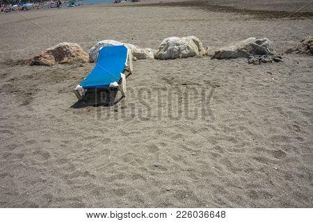 Sunbed On The Rocky Beack At Malagueta In Malaga, Spain, Europe