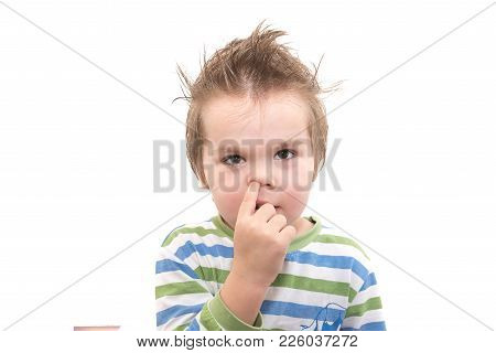 Handsome Little Boy Picking His Nose Isolated On White Background For Any Purpose
