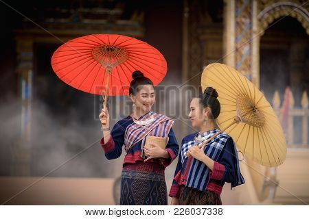 Portrait Of Young Women Wearing Old Fashion And Local Styles In The Temple., Thailand Cultural