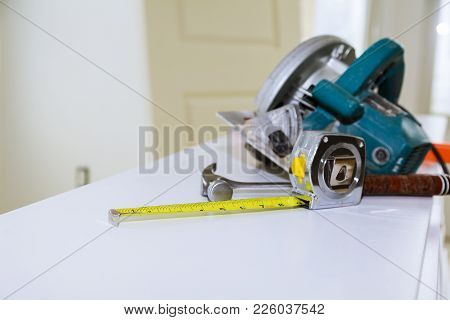 The Table With The Tools Of A Carpenter. On The Table Saw, Planer, Chisels, Tape Measure, Electric J