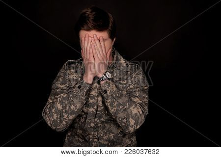 Despondent Male Soldier Covering His Face With Hands. Concept Of Despair. Isolated On Background