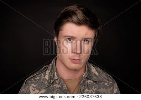 Cheerless Young Veteran Looking At Camera With Upset Look. He Is Feeling Hopeless And Loneliness. Is