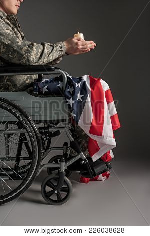 Handicapped Veteran Holding Suppository And Flag In His Hands. Close Up. He Is Sitting In Invalid Ch