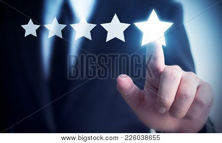 Businessman Hand Touching Five Star Symbol To Increase Rating Of Company Concept, Copy Space Backgro