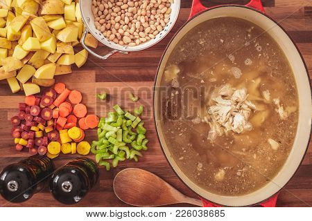 Overhead View Of The Ingredients Used To Make Homemade Chicken And White Bean Soup.  Ingredients Inc