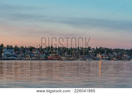 View Of The Famous Harbor Front Of Lunenburg After The Sunset (during The Nova Scotia Tall Ship Fest