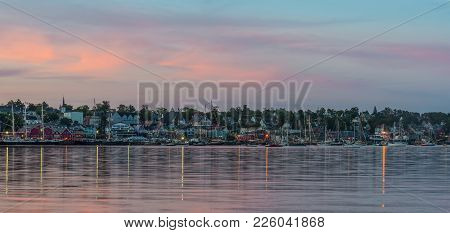 Panoramic View Of The Famous Harbor Front Of Lunenburg At Night (during The Nova Scotia Tall Ship Fe