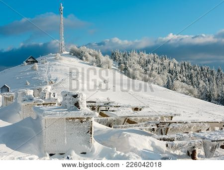 Beautiful Winter Mountain Landscape With Rime Frosting And Snow Covered Resting Place, Snowdrifts, C