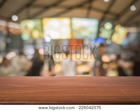 Empty Wood Table Top On Blur Bakery Shop Or Cafe Restaurant With Abstract Bokeh Background, Perspect