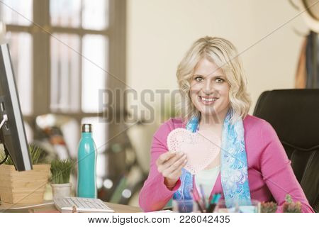 Professional Woman In Office With A Valentine Heart
