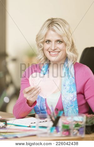 Smiling Professional Woman With A Valentine Heart