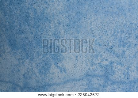 Grungy Blue Concrete Wall Background. Background From High Detailed Fragment Stone Wall.