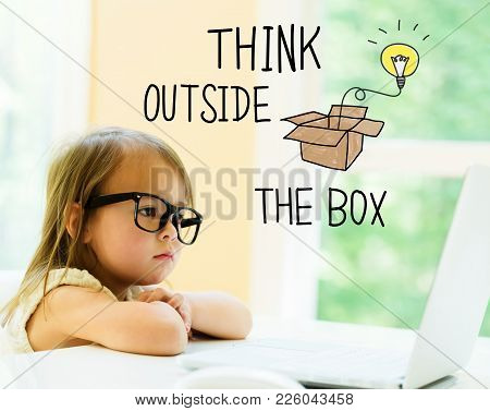 Think Outside The Box Text With Little Girl Using Her Laptop