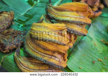 Asian Traditional Spicy Dried Fish Food On Green Banana Leaf. Thai Food