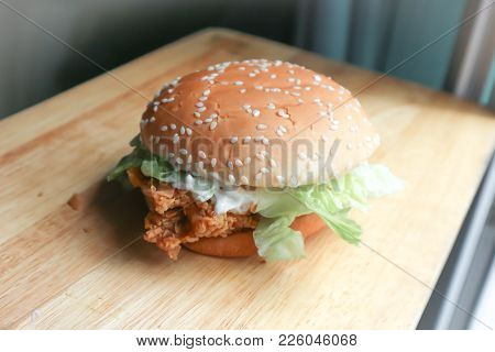 Chicken Burger With Lettuce In The Wooden Tray