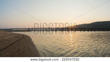 Panorama Viewe Of Ong Cop Bridge By Sunset Period, The Longest Wooden Bridge In Vietnam