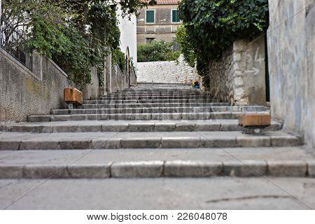 Narrow Alleys With Stone Stairs Between Old Brick Houses In Split/ Typical Mediterranean Street- Cro