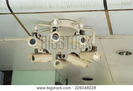 Monitoring Cameras On The Streets Of Singapore. Outdoor Police Cctv At Transportation Station In The