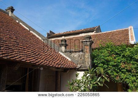 Aged red tiled rooftop in Duong Lam ancient village, Hanoi, Vietnam poster