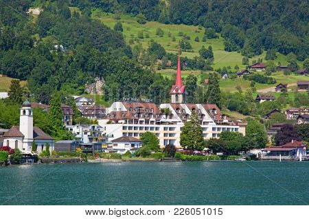 Weggis, Canton of Lucerne / Switzerland - July 03 2016: View of the picturesque old village Weggis. Weggis is popular recreational resort in the german speaking part of Switzerland.
