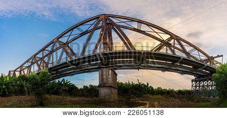 Side Panorama View Of Long Bien Ancient Metal Bridge At Early Morning In Hanoi, Vietnam