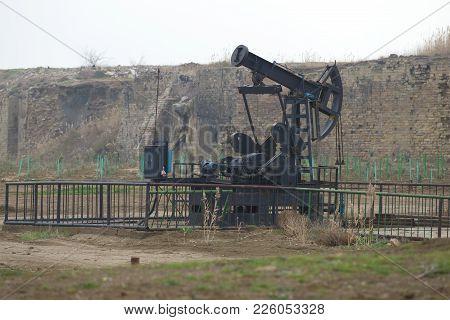 Baku, Azerbaijan - January 04, 2018: Oil Pump On A Cloudy January Day