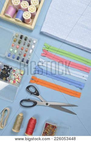 Flat Lay Of Sewing Material Contains The Fabrics, Scissors, Shirt Buttons, Zipper, Pin And Colorful