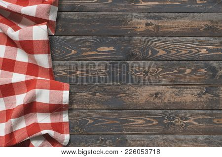 wooden table top view with red picnic cloth
