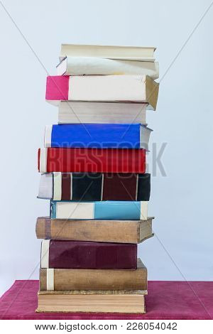Stack Of Old Books In A Library