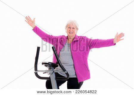 Happy Female Senior Train With Fitness Machine