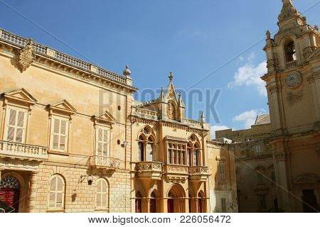 House Facade At St. Pauls's Square And St. Paul's Cathedral In Mdina, Malta