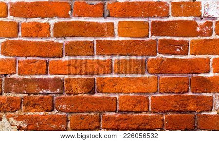 Old Wall Made Of Red Brick. Background Of Old Bricks. Century-old Brick. The Brick Wall Is Old. Vint