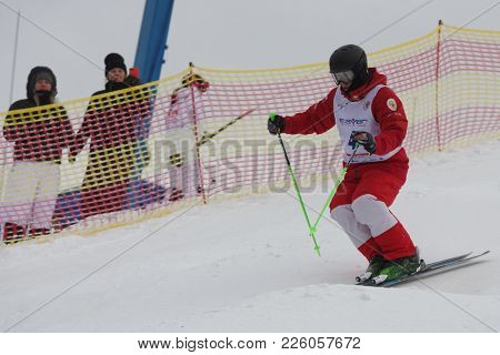 KRASNOE OZERO, LENINGRAD REGION, RUSSIA - FEBRUARY 1, 2018: Timur Rakhmatullin of Russia competes in dual mogul during Freestyle Europa Cup competitions. Rakhmatullin takes 4th place