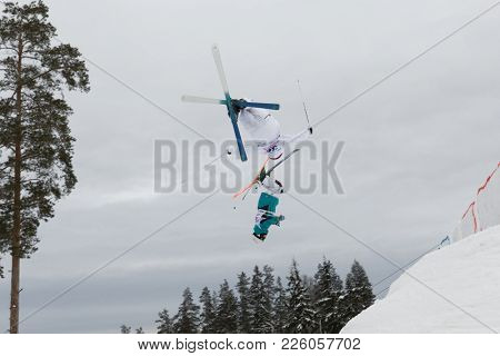 KRASNOE OZERO, LENINGRAD REGION, RUSSIA - FEBRUARY 1, 2018: Albin Holmgren (36) of Sweden and Michail Dolmatov of Russia compete in dual mogul during Freestyle Europa Cup competitions