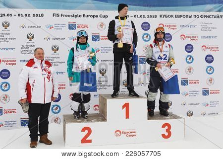 KRASNOE OZERO, LENINGRAD REGION, RUSSIA - FEBRUARY 1, 2018: Winners in mogul of Freestyle Europa Cup during award ceremony. Left to right on podium: Bragin, Uglovski, Novitckii, all of Russia