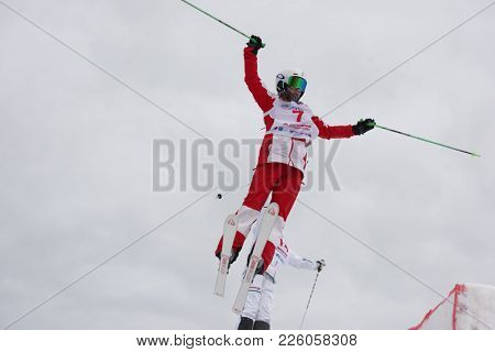 KRASNOE OZERO, LENINGRAD REGION, RUSSIA - FEBRUARY 1, 2018: Anastasiia Smirnova (red) of Russia and Frida Lundblad of Sweden compete in dual mogul during Freestyle Europa Cup competitions