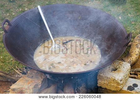 Thang Co Is Cooking Outdoor On Big Pan - Vietnamese Ethnic Food Made Of Horse Internal Organs