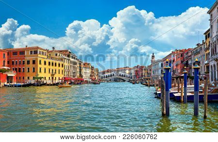 Bridge Rialto on Grand canal famous landmark panoramic view Venice Italy with blue sky white cloud.