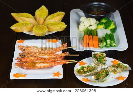 Set Of Vietnamese Food With Grilled Tiger Shrimps, Barbecue Geoduck With Onion And Grease, Butter Br