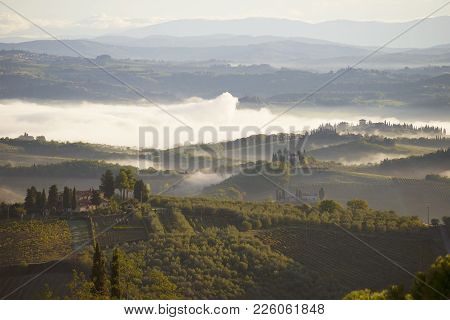 Tuscany, Italy - September 25, 2018: A Foggy September Morning In The Vicinity Of San Gimignano