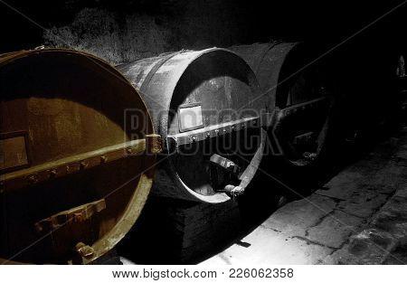 Old Wooden Casks Of Wine In A Underground Cellar