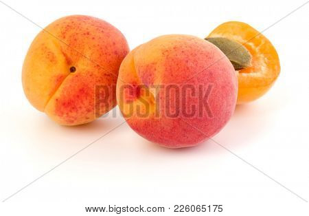 three apricot fruit isolated on white background cutout
