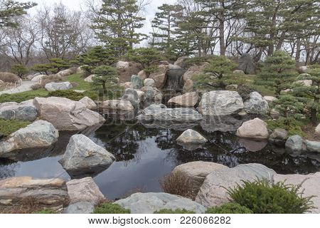 A Peaceful And Quiet Pond And Garden