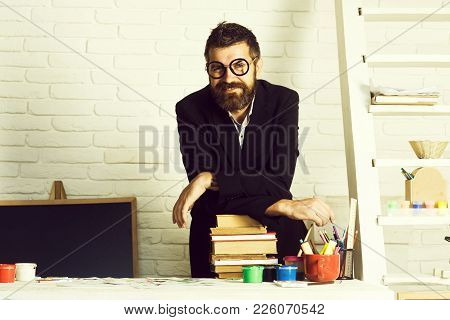 Teacher Student, Happy Bearded Young Guy In School Or Classroom With Books On Desktop In September B