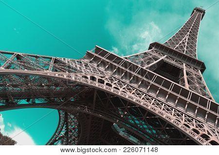 Eiffel Tower, Paris, Against A Clear Sky.