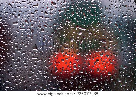 Drops Of Rain On Glass, The Lights Of The Diesel Locomotive. Background Image Of Railway Transport.